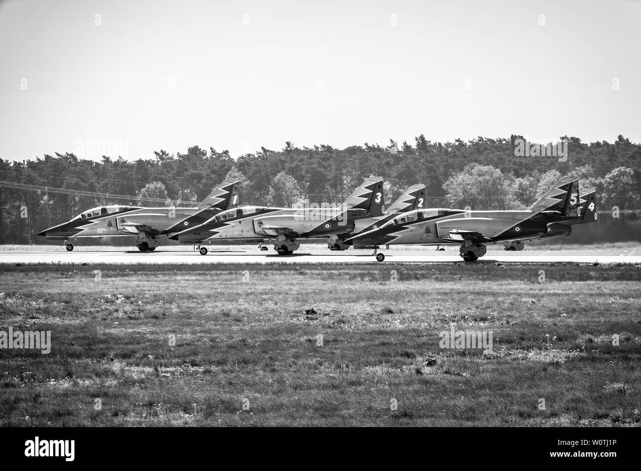 BERLIN - APRIL 28, 2018: Advanced jet trainer CASA C-101 Aviojet by the aerobatic team Patrulla Aguila (Eagle Patrol) on the runway. Black and white. Exhibition ILA Berlin Air Show 2018. - Stock Image