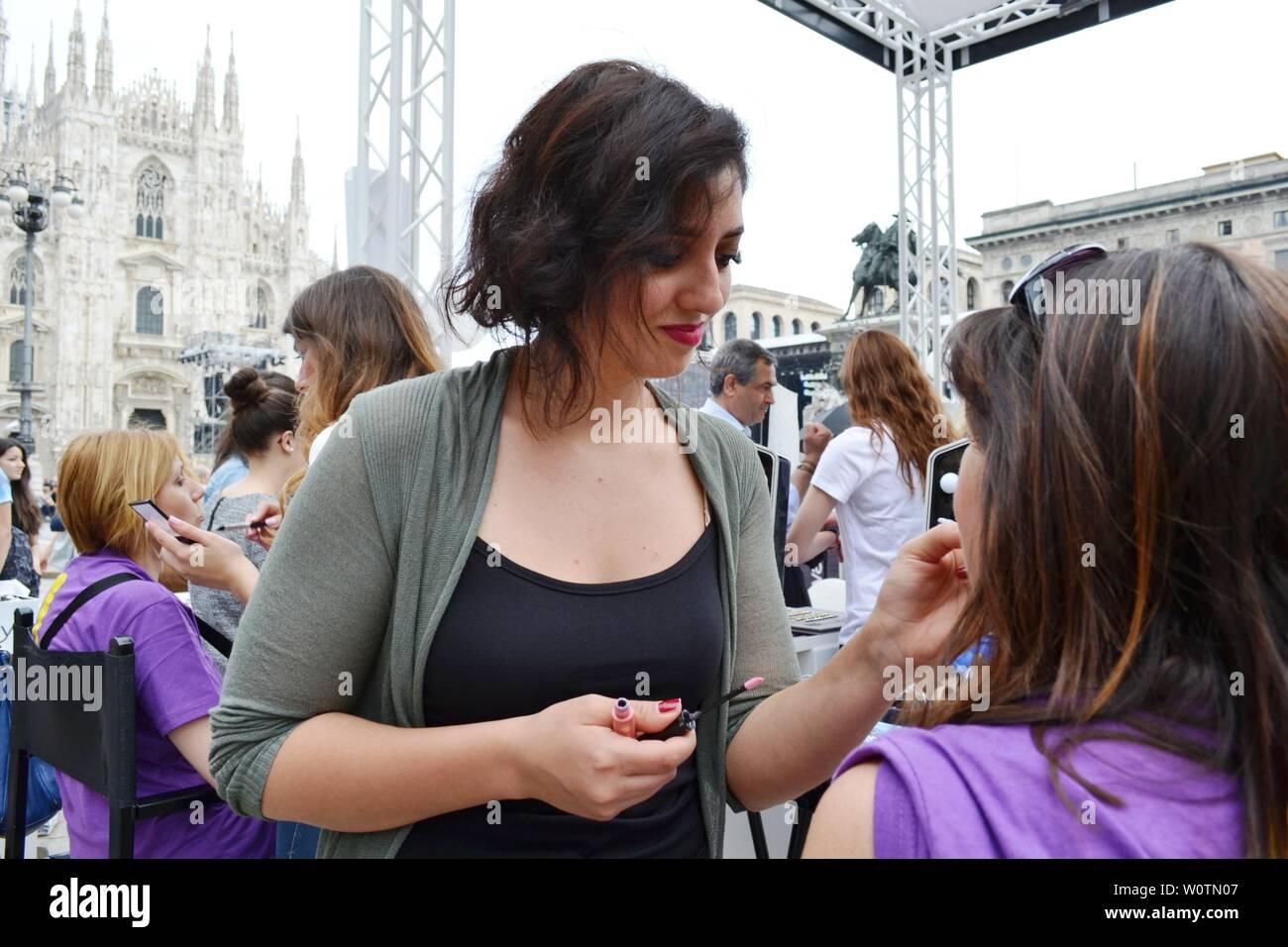 "Milan, Italy - June 9, 2016:  Beauticians receiving customers for outdoors fun photo set ""Posa per Brosway"" during ""Radio Italia live al concerto"". Stock Photo"