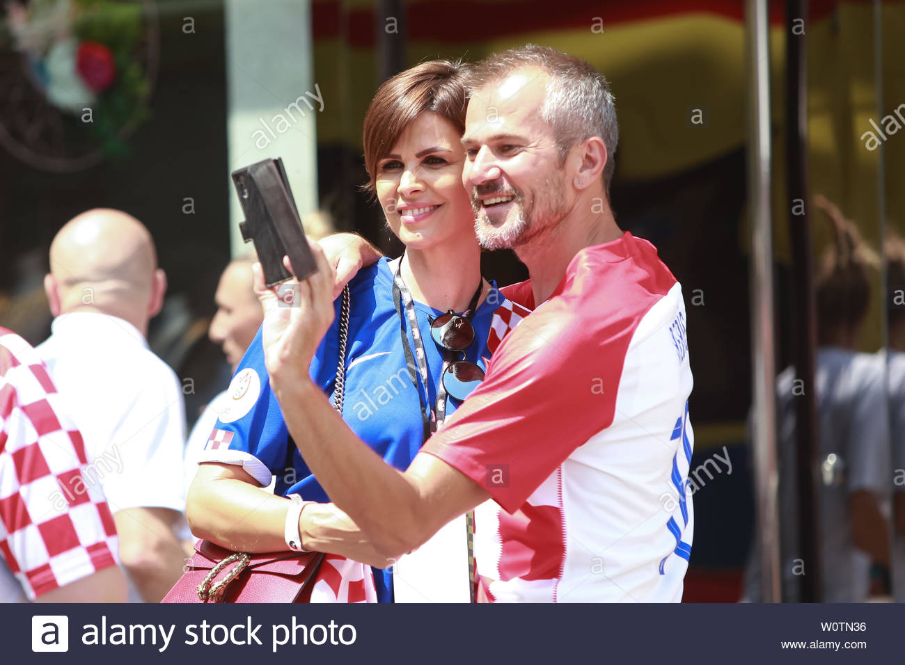 ZAGREB,CROATIA -JULY 16, 2018 : National Team welcome home celebration. Anica Kovac former model known for being the First Runner-up in the Miss World 1995 competition with Croatian fan taking selfie. - Stock Image