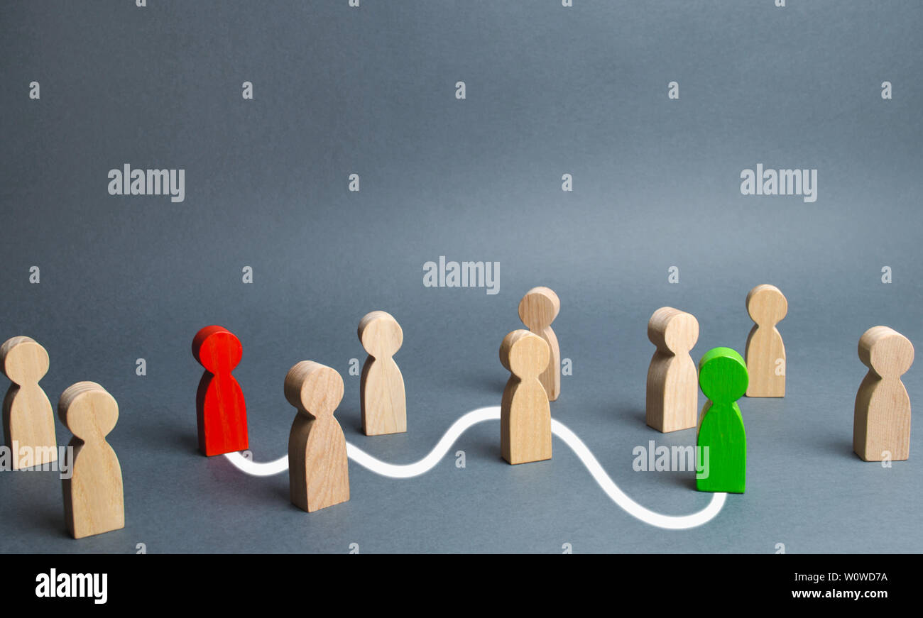 The red and green figures are connected by a white line passing through the crowd. Communication between people, search, capture, acquaintance. Find y - Stock Image