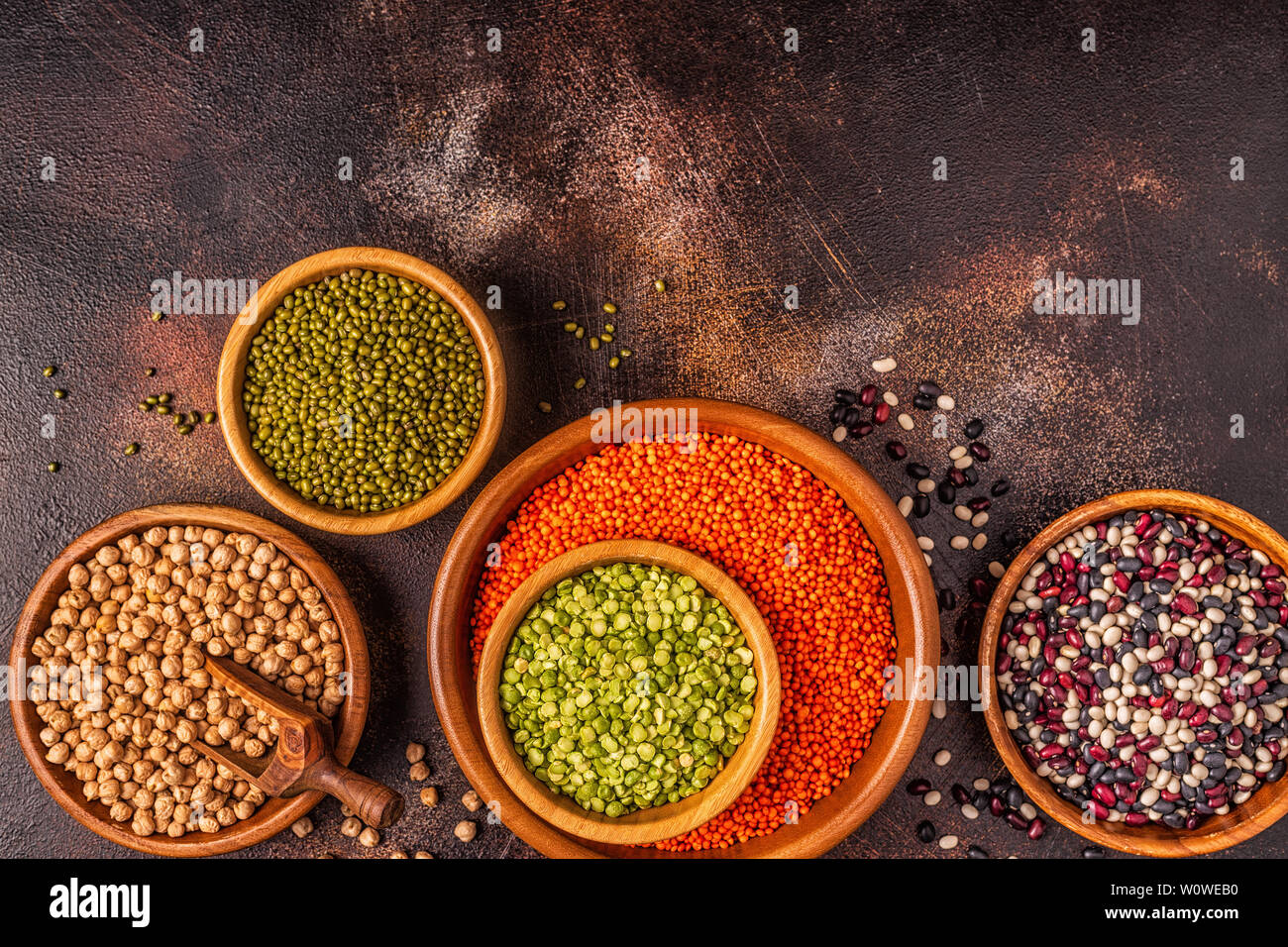 Assortment  of Legumes - lentils, peas, mung, chickpeas and different beans. Top view. - Stock Image