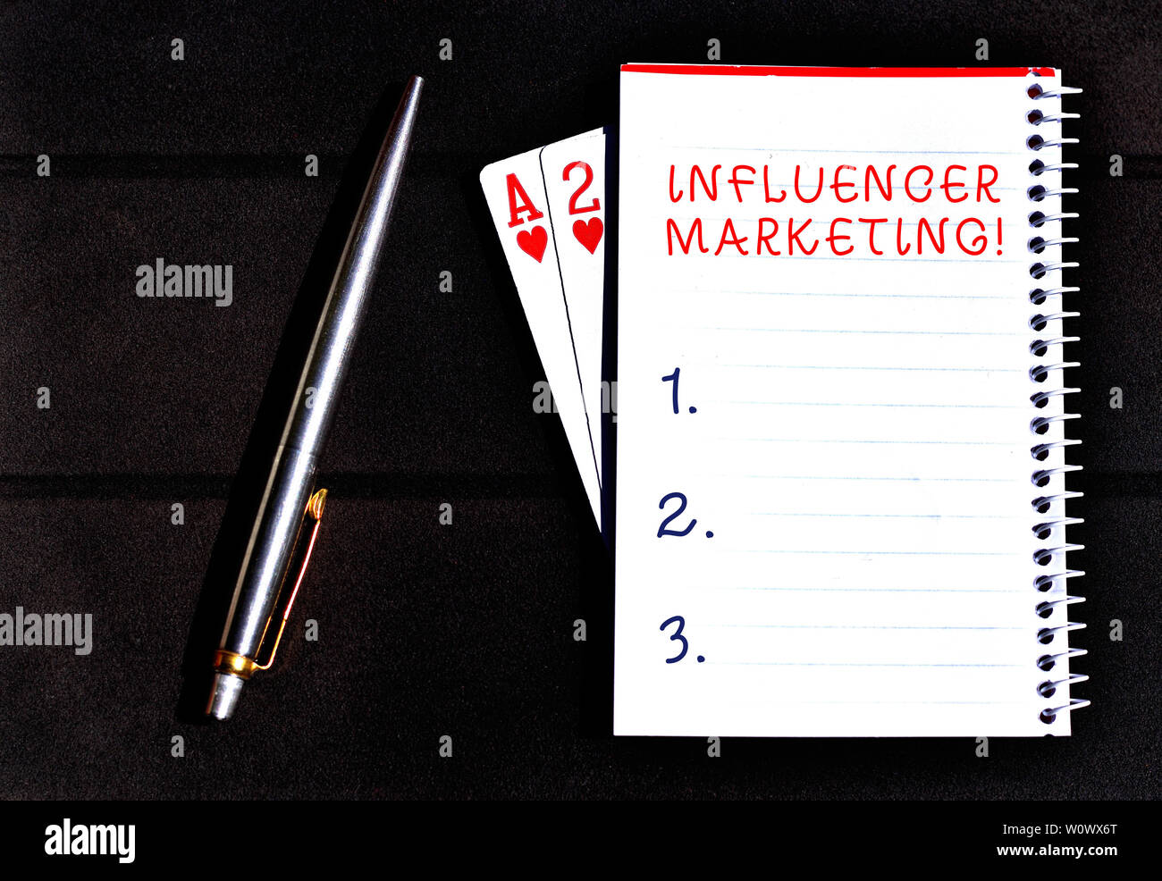 Conceptual hand writing showing Influencer Marketing. Concept meaning Endorser who Influence Potential Target Customers Writing equipments placed next - Stock Image