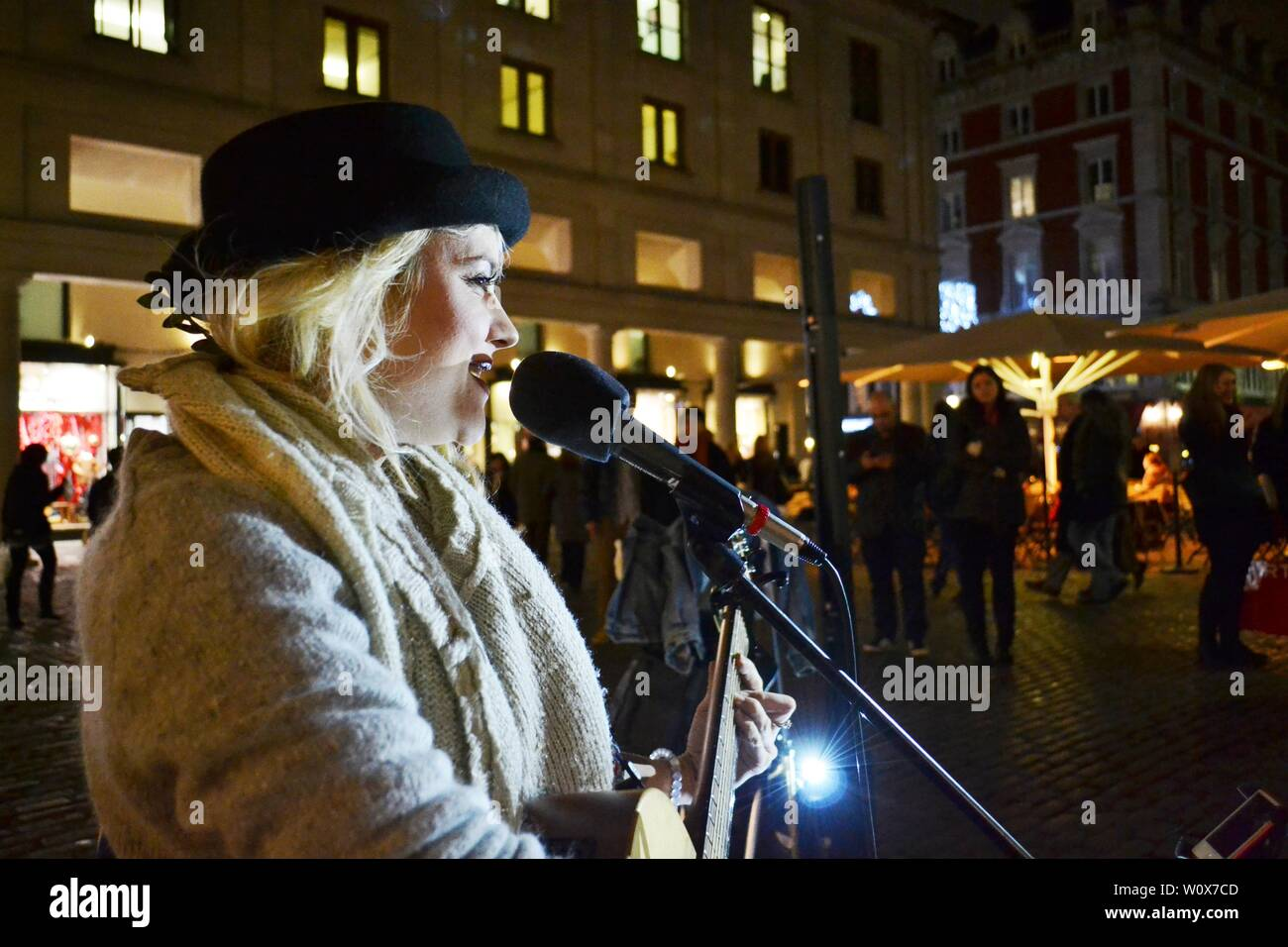 London/UK - November 27, 2013: London singer, guitarist and song writer Sammie Jay singing by night at the Covent garden square during Christmas. Stock Photo