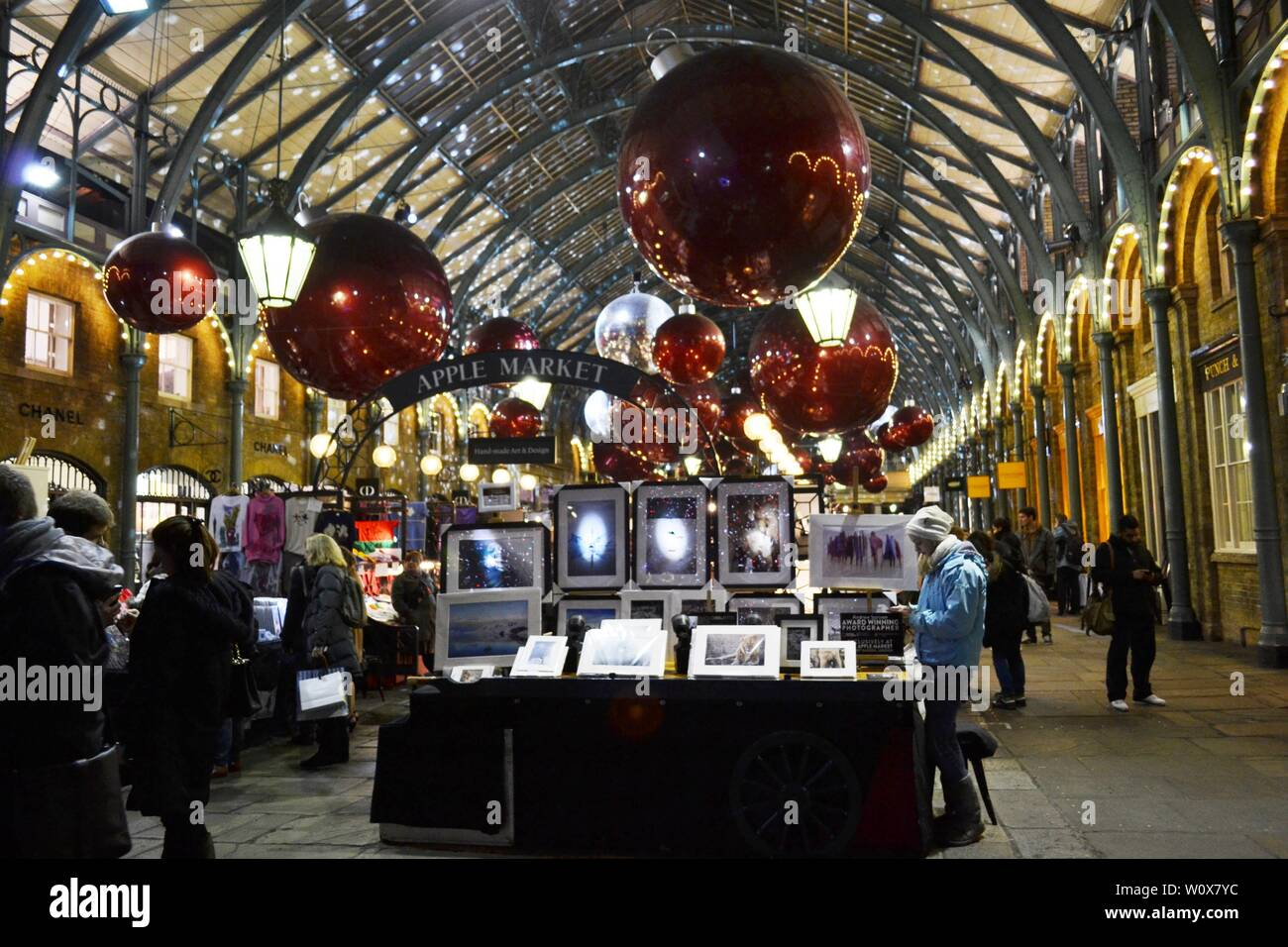 London/UK - November 27, 2013: People shopping at the Covent Garden Apple market decorated for Christmas holidays. Stock Photo
