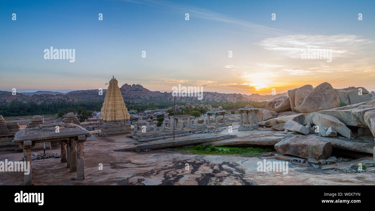A panoramic view over Hampi with its temple and ruins at sunrise - Stock Image