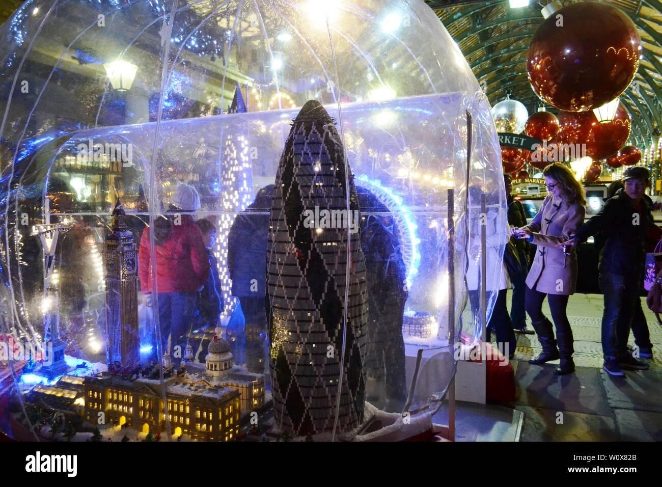 London/UK - November 27, 2013: People enjoying models of London famous landmarks exposed in the Covent Garden Apple market decorated for Christmas. Stock Photo