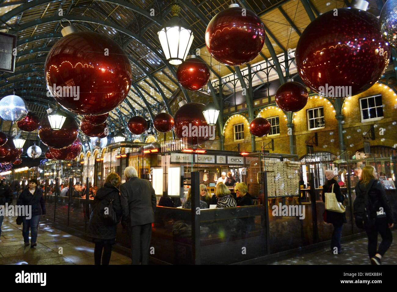London/UK - November 27, 2013: People eating at the Covent Garden restaurant space during Christmas holidays. Stock Photo