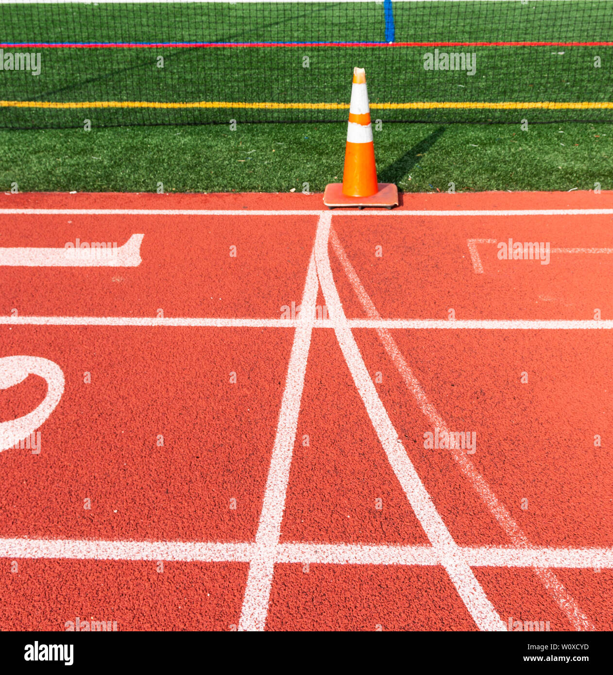 Side view showing the start and finish line marked by an orange cone on a track. Stock Photo