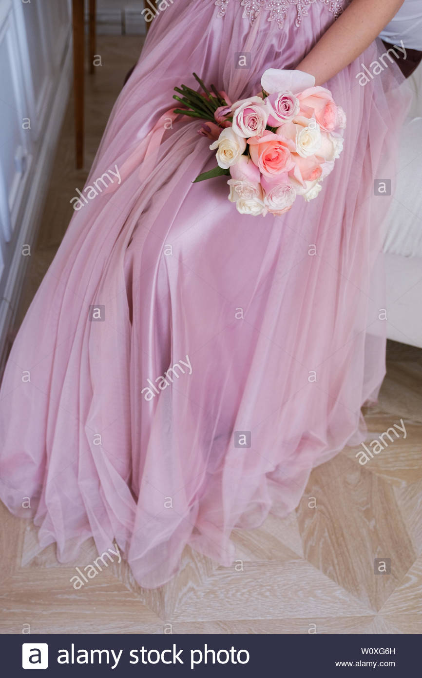 The Bride In The Wedding Dress Powder Color Holds A Beautiful