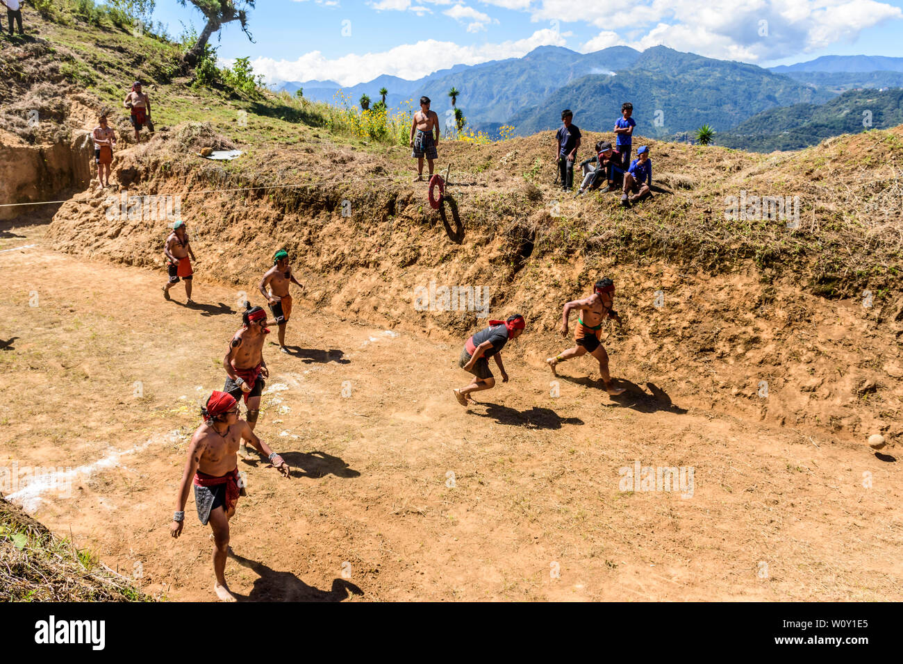 San Andres Semetabaj, Lake Atitlan, Guatemala - November 10, 2018:  Local indigenous Maya men play Maya ballgame in a newly dug ballgame court. - Stock Image