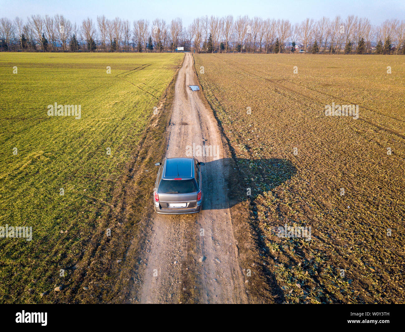 Aerial View Of Car Driving By Straight Ground Road Through Green Fields On Sunny Blue Sky Copy Space Background Drone Photography Stock Photo Alamy