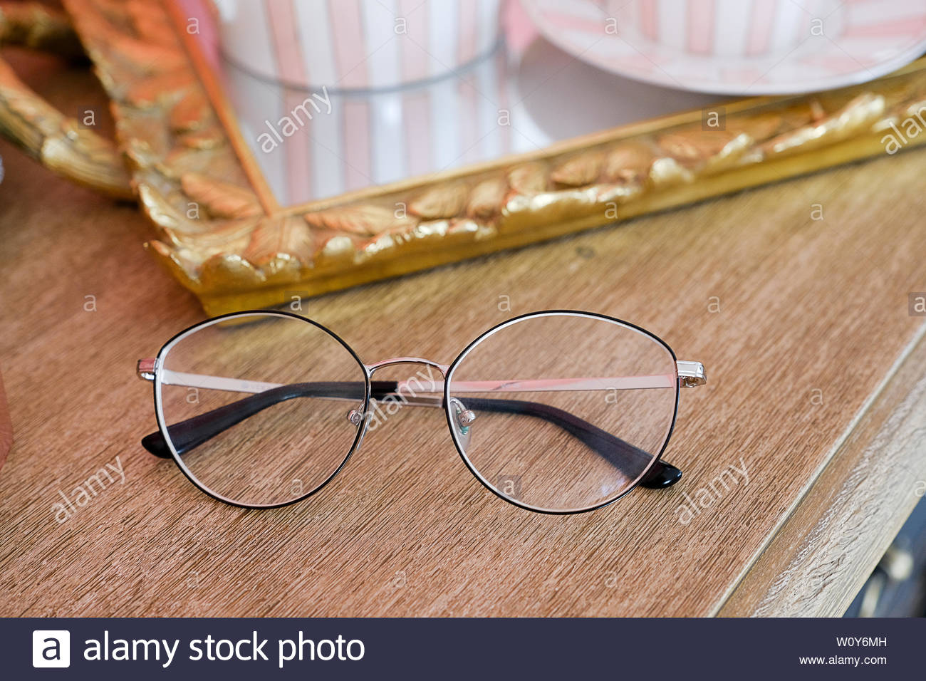 6f21d75ea40f Black-rimmed glasses with glass lenses, on a wooden chest or table. Vintage