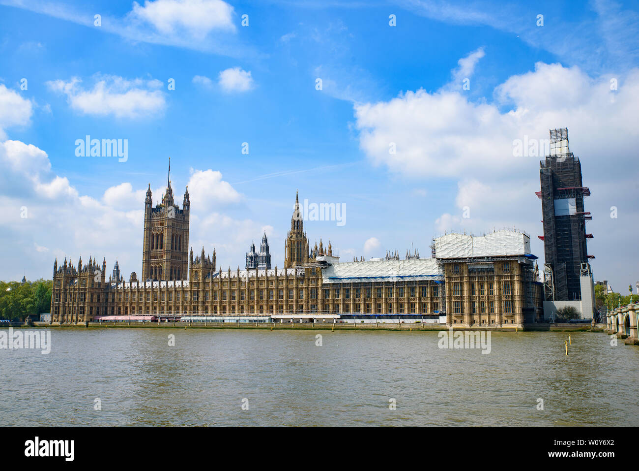 The Palace of Westminster as the Houses of Parliament on the north bank of the River Thames in London, United Kingdom Stock Photo