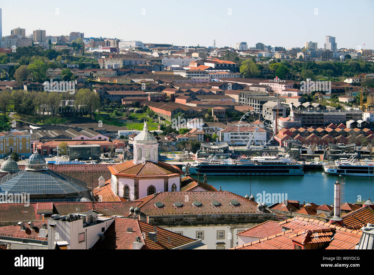 A view of the port wine lodges on Vila Nova de Gaia side of River Douro,  tourist ships & roofs of Ribeira Porto Oporto Portugal   KATHY DEWITT Stock Photo