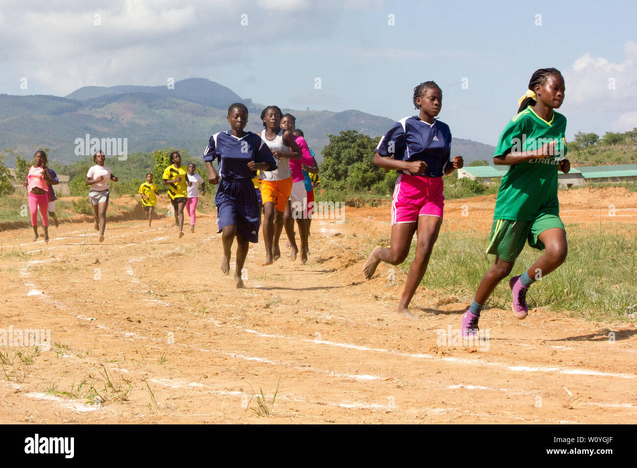 High school girls competing on a running event at the Festival of School Sports Games in Chinhamapere Secondary School - Stock Image
