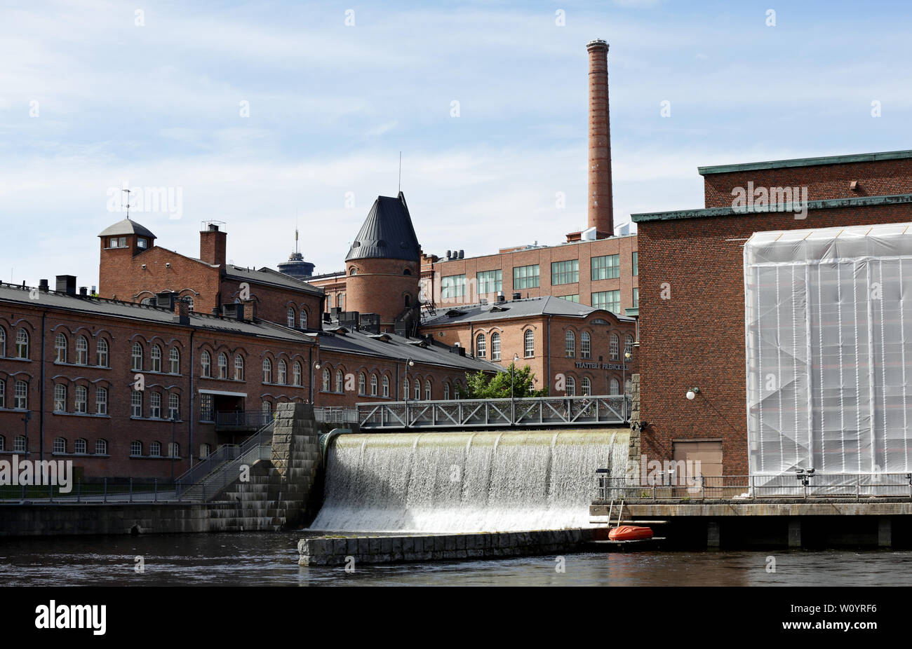Tampere Finland 06/12/2019  Tammerkoski (rapids in Tampere) flowing in the area of  Tampella and Finlayson - Stock Image
