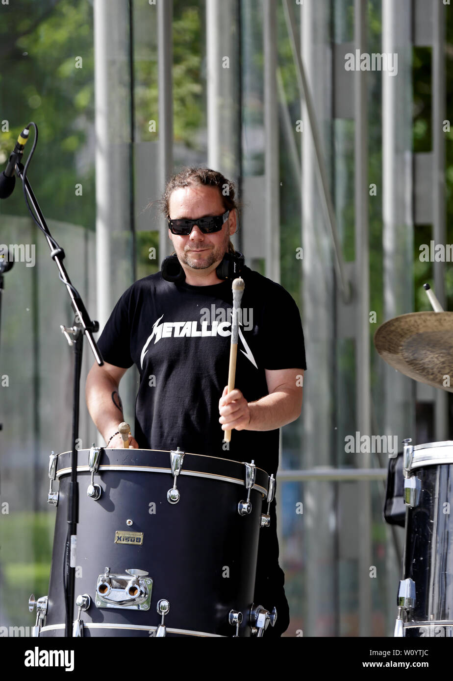 Tampere Finland 06/12/2019 Public park A band of drummers and blowers training on a stage in the middle of the city in the warm summer evening. - Stock Image