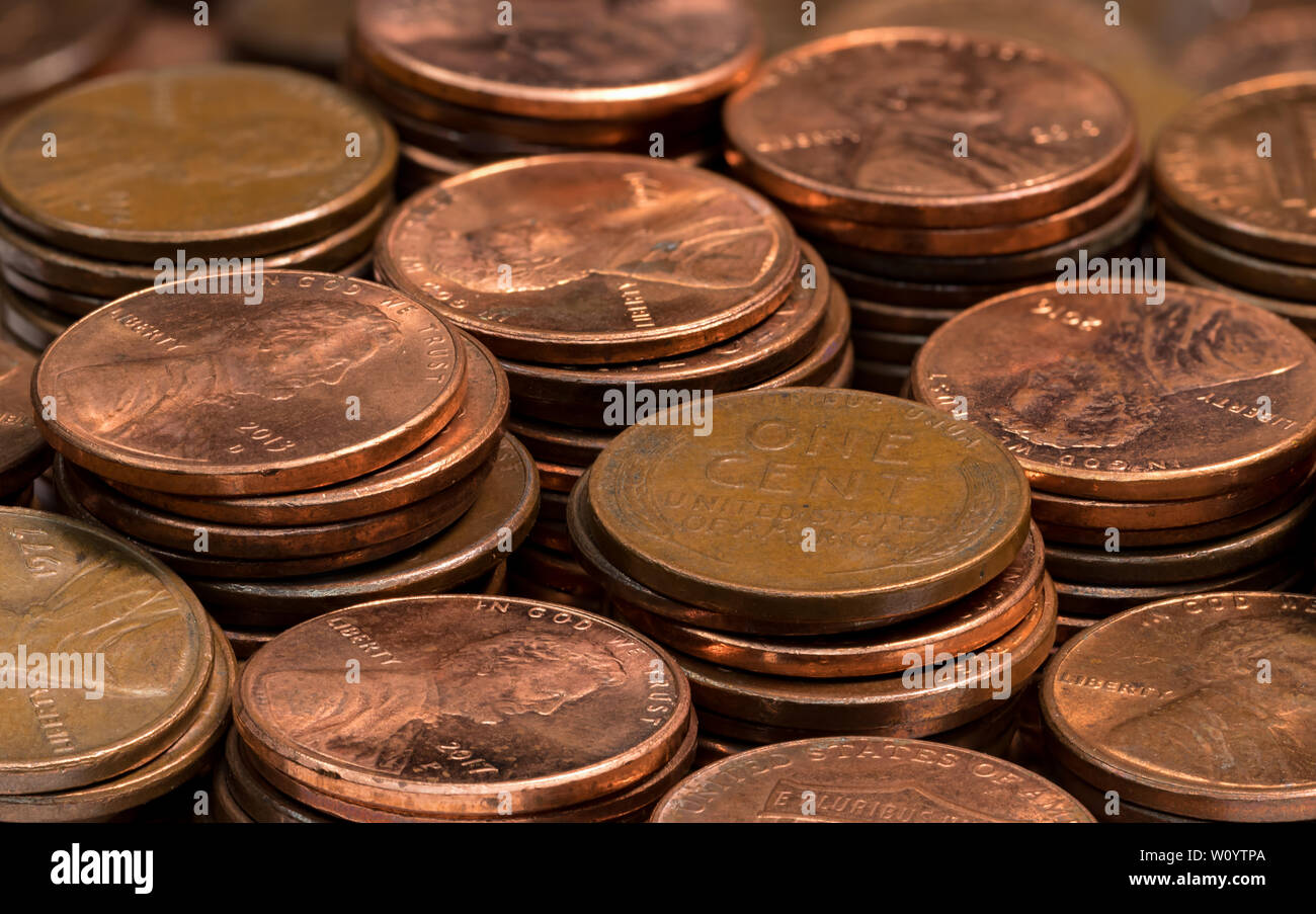 stacked coins, pennies, lined up in rows Stock Photo