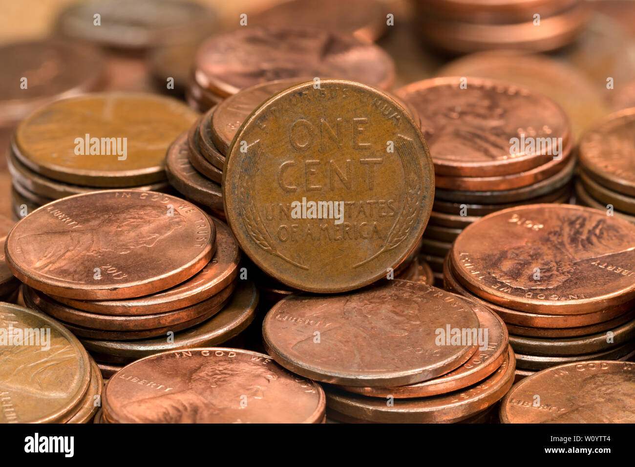 stacked coins, pennies, lined up in rows - Stock Image