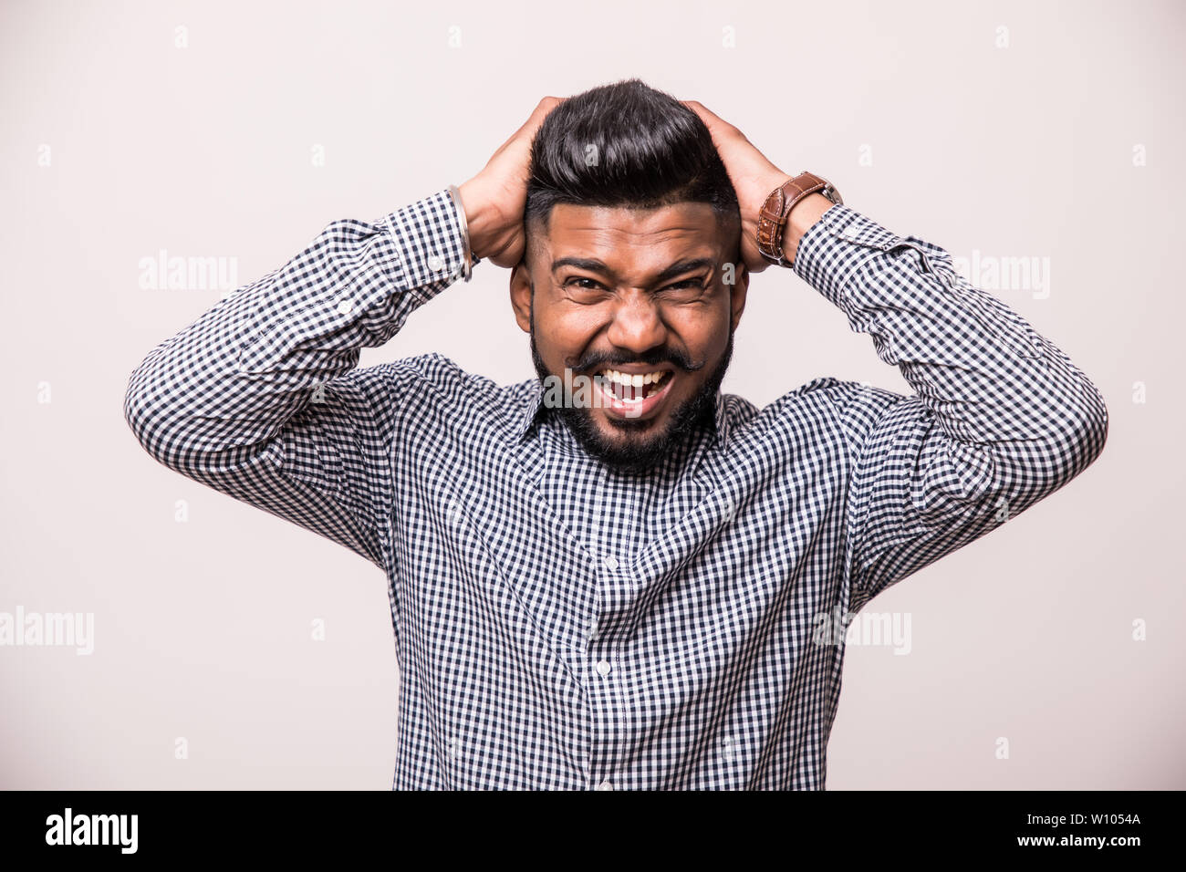 Hipster energetic man announcing something loudly. Isolated on white background. - Stock Image