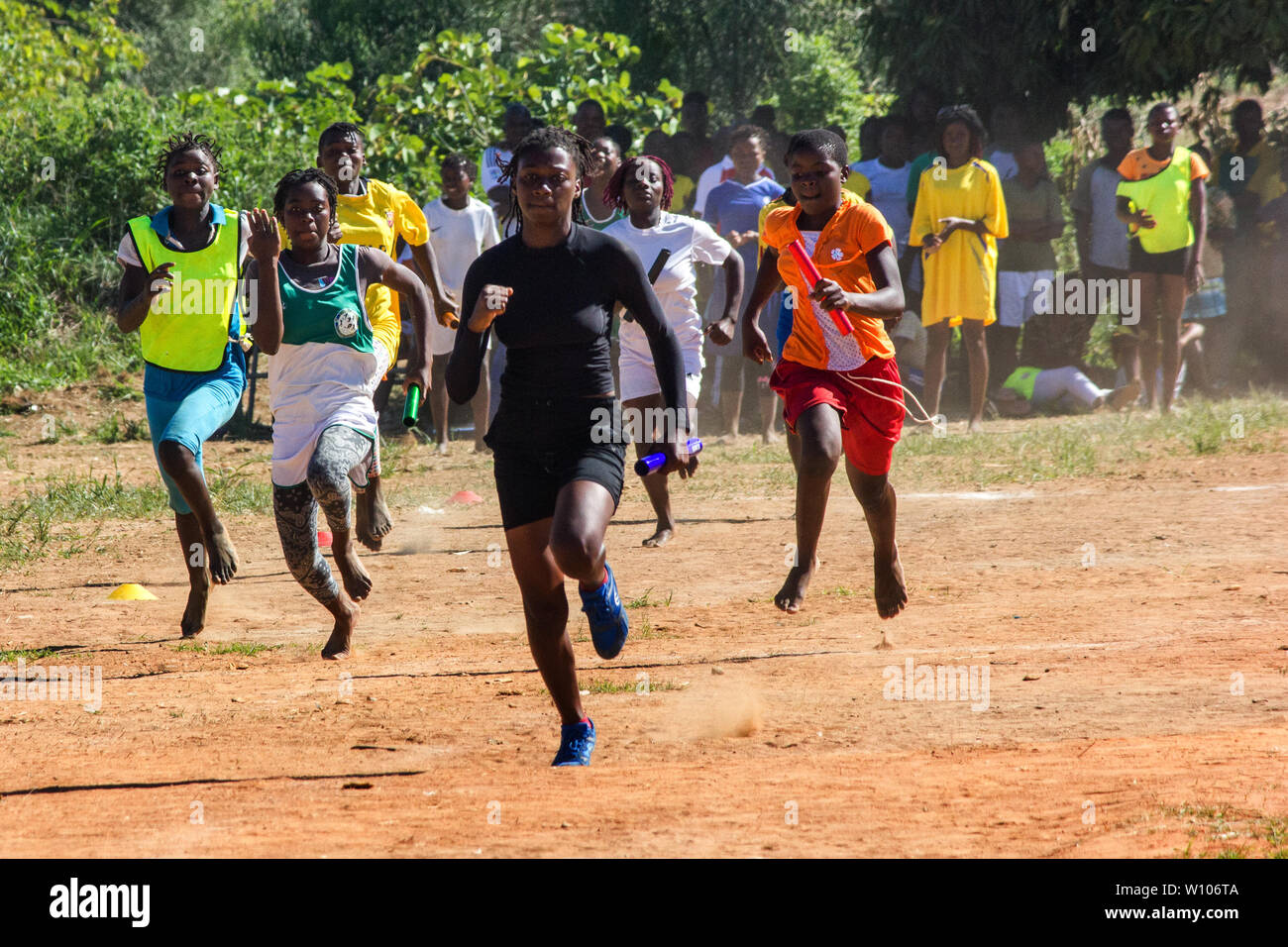 High school girls competing on a race track at the Festival of School Sports Games in Chinhamapere Secondary School - Stock Image