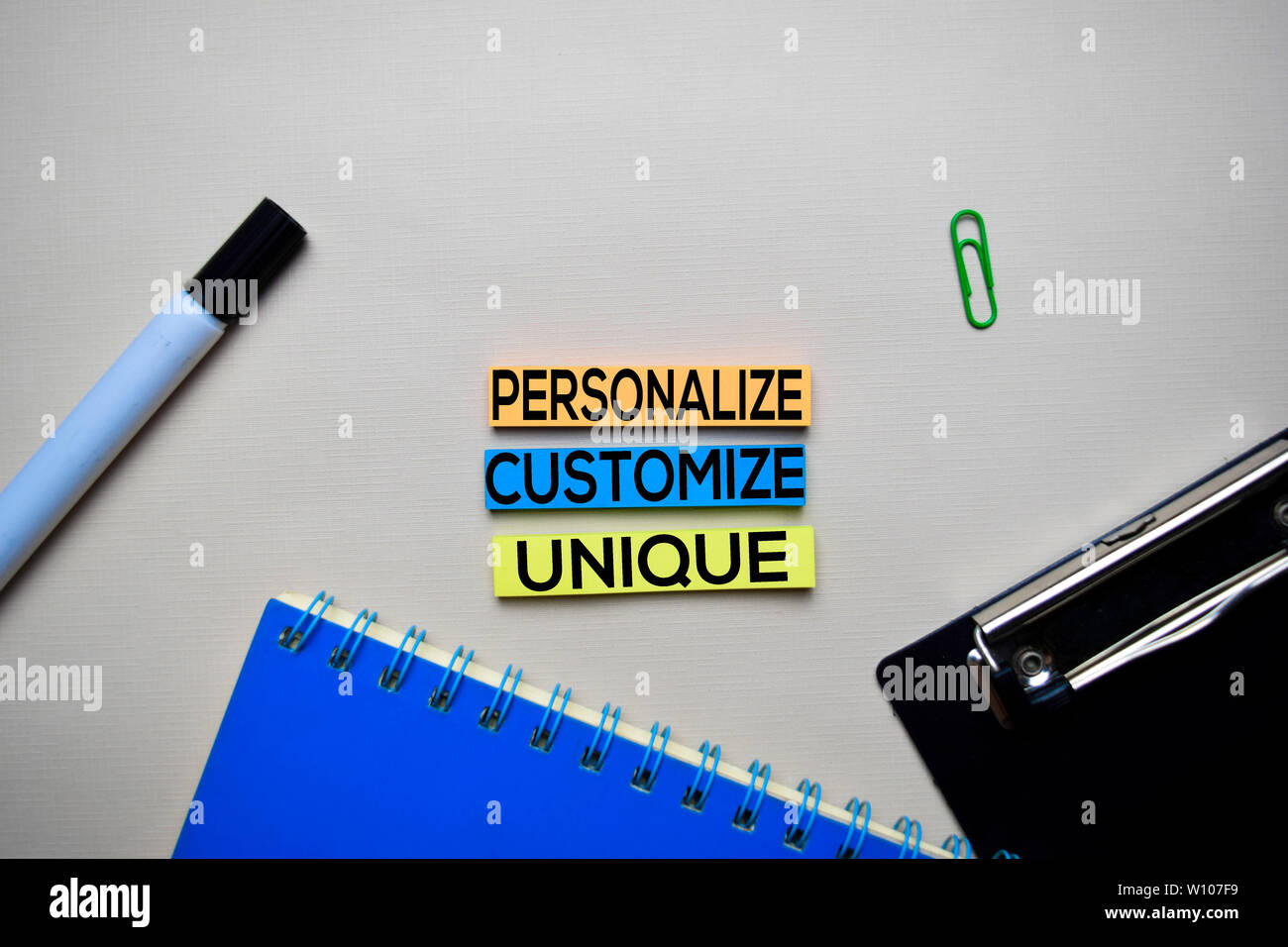 Personalize - Customize - Unique text on sticky notes with office desk concept - Stock Image