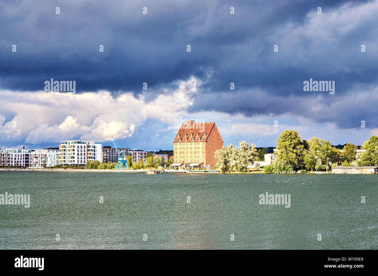 Dramatic clouds over the lake and the city of Schwerin. Mecklenburg-Vorpommern, Germany - Stock Image