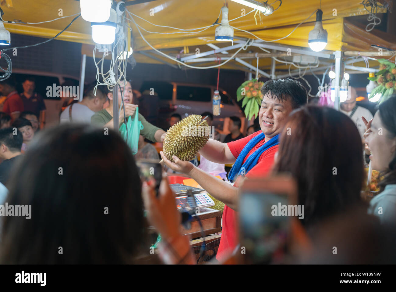 KOTA KINABULU, BORNEO - JUNE 1 2019; Night street market for locals selling delicacy but smelly durian fruit - Stock Image