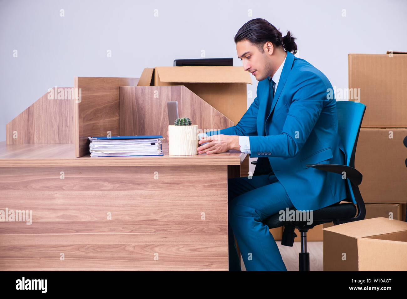 Young handsome businessman being fired from his work - Stock Image
