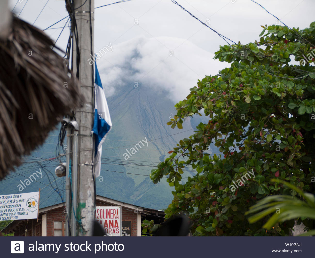 Behind Moyogalpa, the main landing port on Ometepe  Island  is Volcan Concepcion, a still active volcano whose last eruption was in 2015. Stock Photo