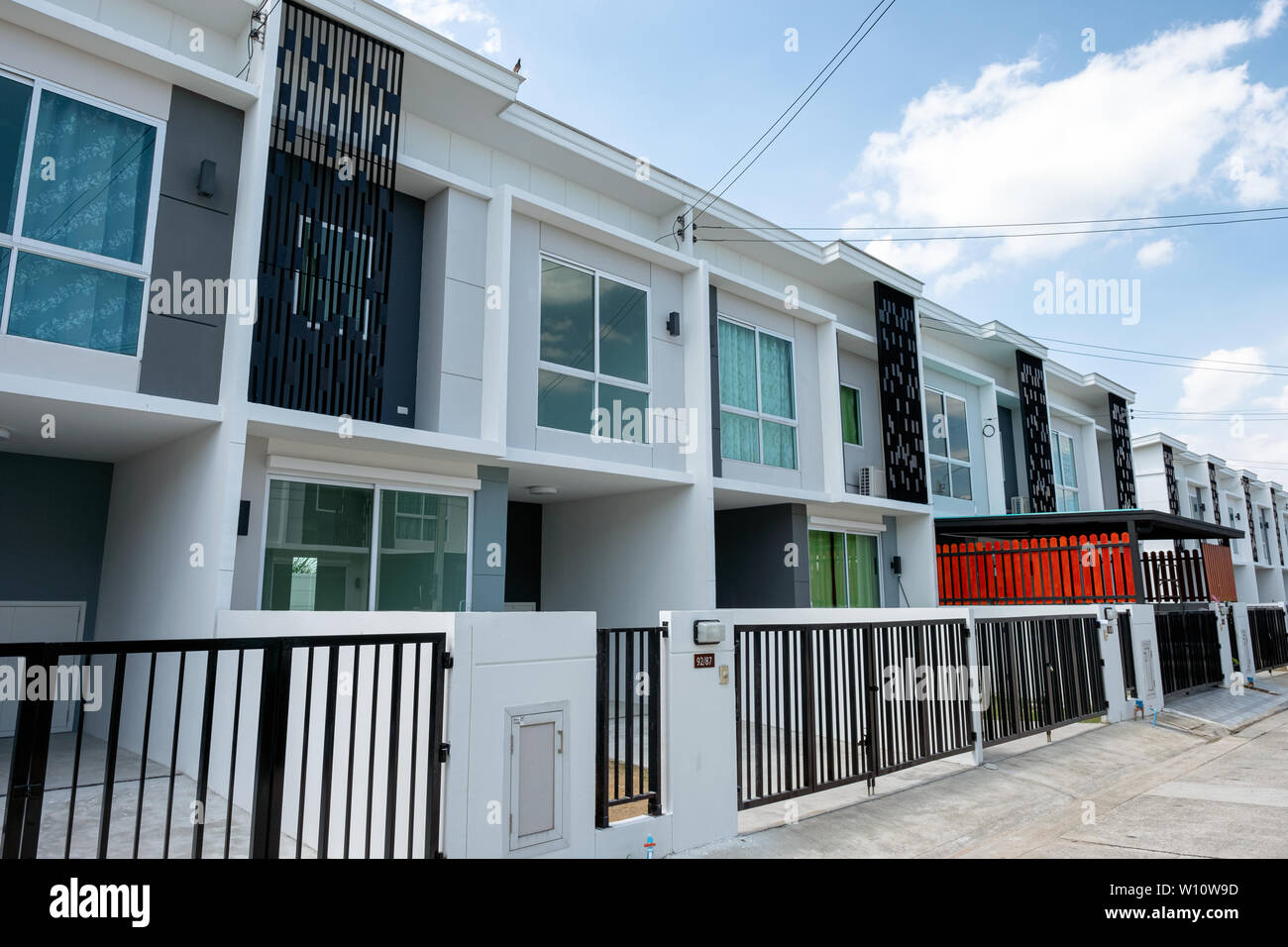 Bangkok, Thailand - June 30 2018 : Village project for sale of modern white townhouse 2 floors with fence in Bang Yai Stock Photo