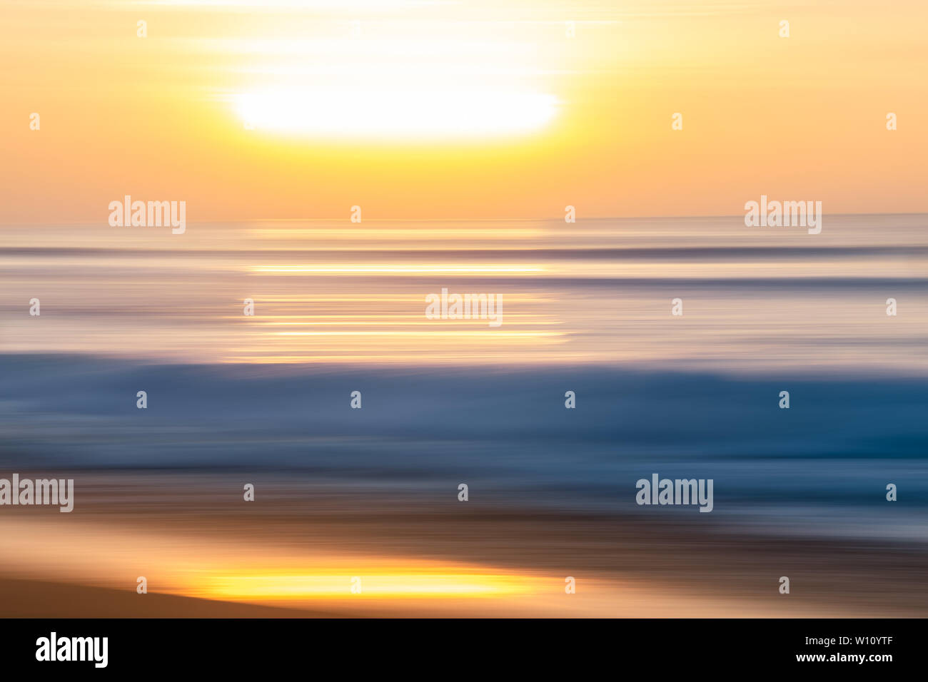 Sunset Over The Sea. Abstract Seascape Background. Water Surface and Sun Reflection - Stock Image