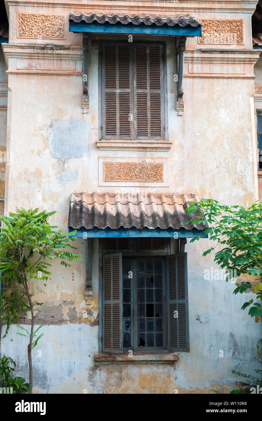 Facade of a French colonial built building opposite That Dam in Vientiane, Laos. - Stock Image