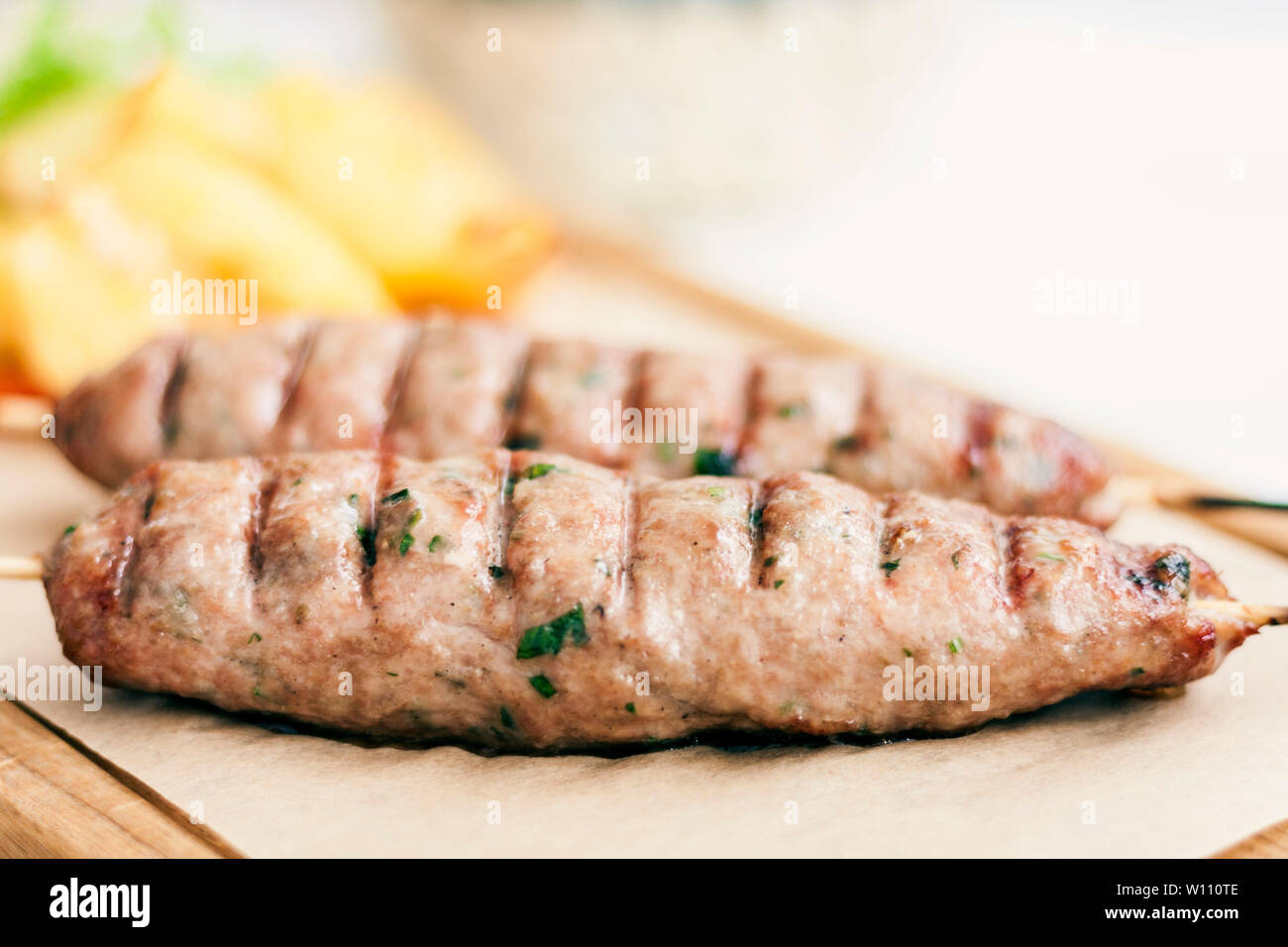grilled minced meat with herbs, traditional Greek lunch in a restaurant - Stock Image