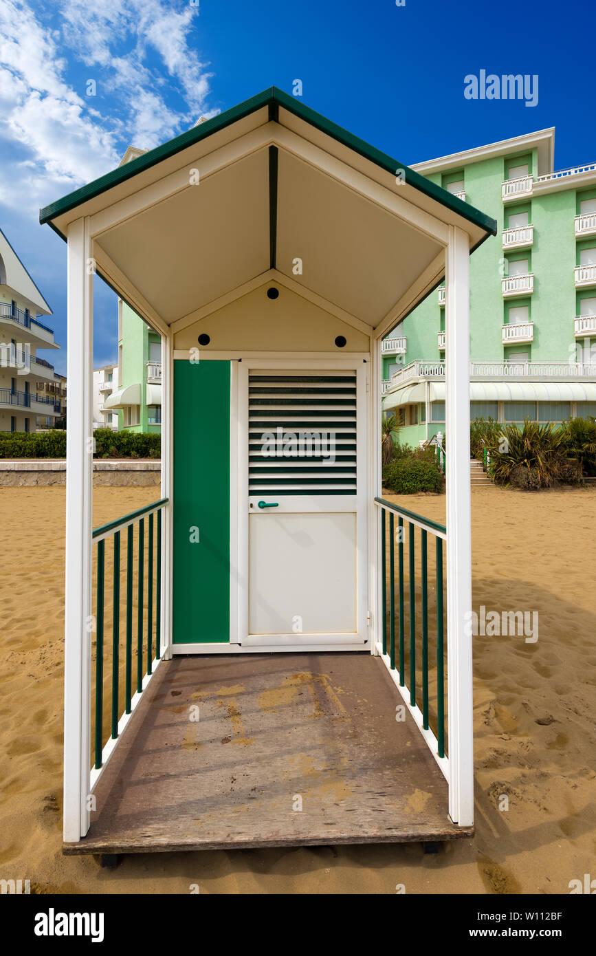 Typical Italian beach hut. On the beach of Caorle in the Adriatic sea, Venezia, Italy Stock Photo