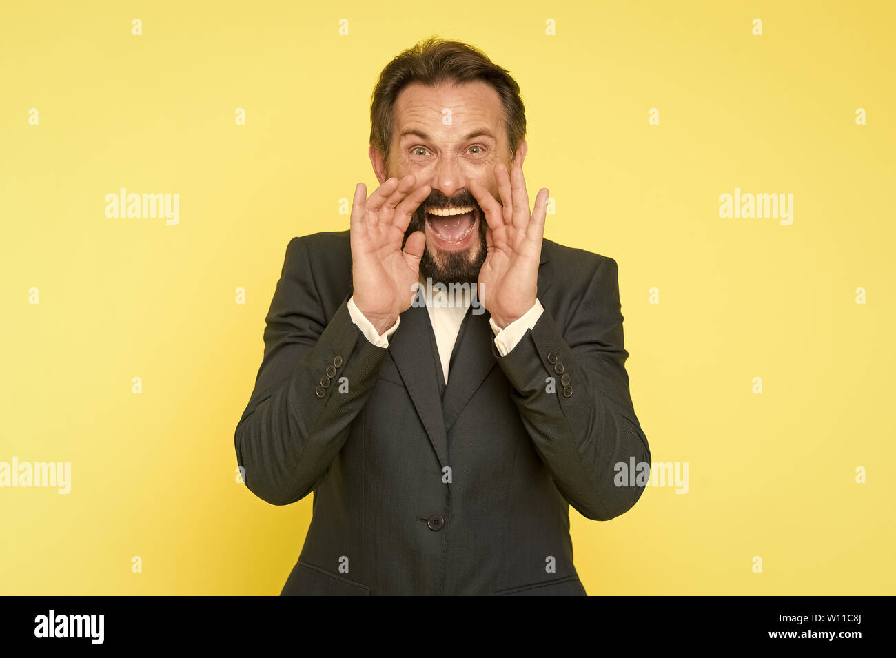 Man shouting to you. Art of negotiations. Man try to persuade you in something. Mature charismatic speaker try to persuade. Public talk and art of persuasive. Oratory concept. Can you hear him. - Stock Image