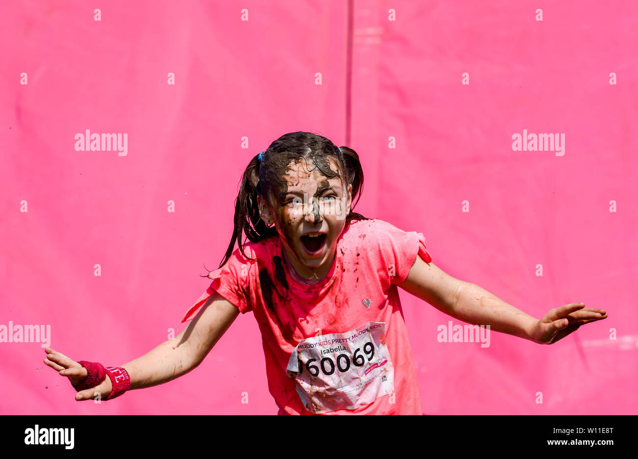 Brighton UK 29th June 2019 - Over a thousand take part  in hot sunny heatwave conditions in the Cancer Research UK Pretty Muddy event in Stanmer Park Brighton . Participants run an obstacle course with mud baths included en route raising money for the charity . Credit: Simon Dack / Alamy Live News - Stock Image