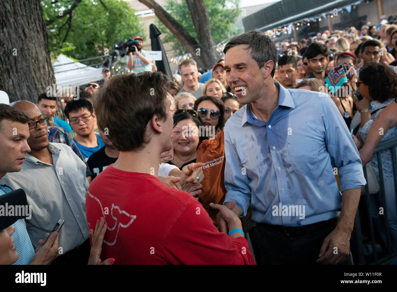 U.S. Democratic presidential primary candidate Beto O'Rourke works up a sweat while greeting some of the 300 supporters attending a campaign rally at Scholtz Garten in downtown Austin, Texas USA. Stock Photo