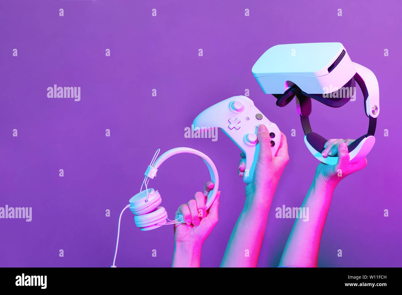 Set of hands with gamepad, virtual reality headset and