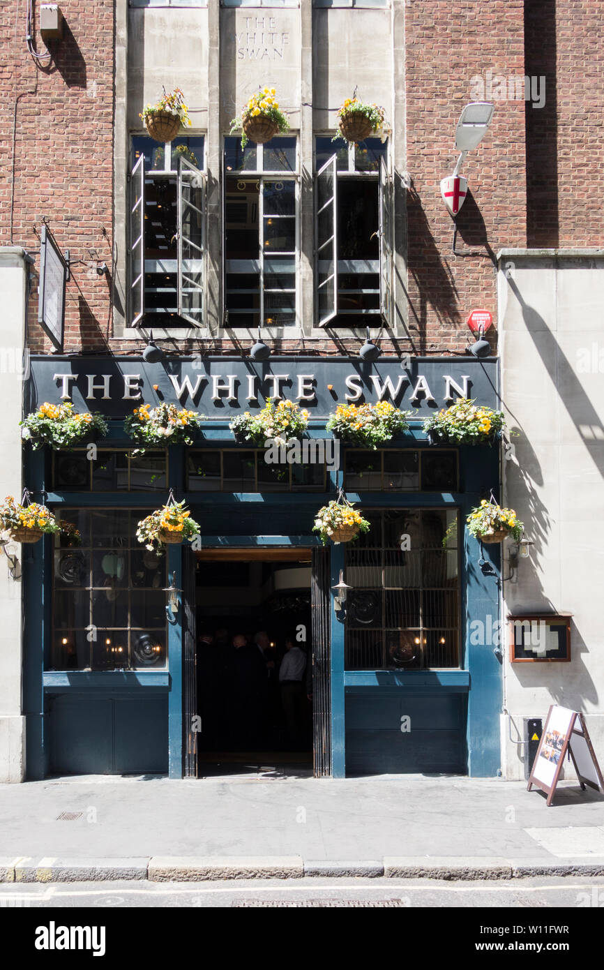 The White Swan public house and chophouse, formerly the Mucky Duck, on Fetter Lane, London, UK Stock Photo