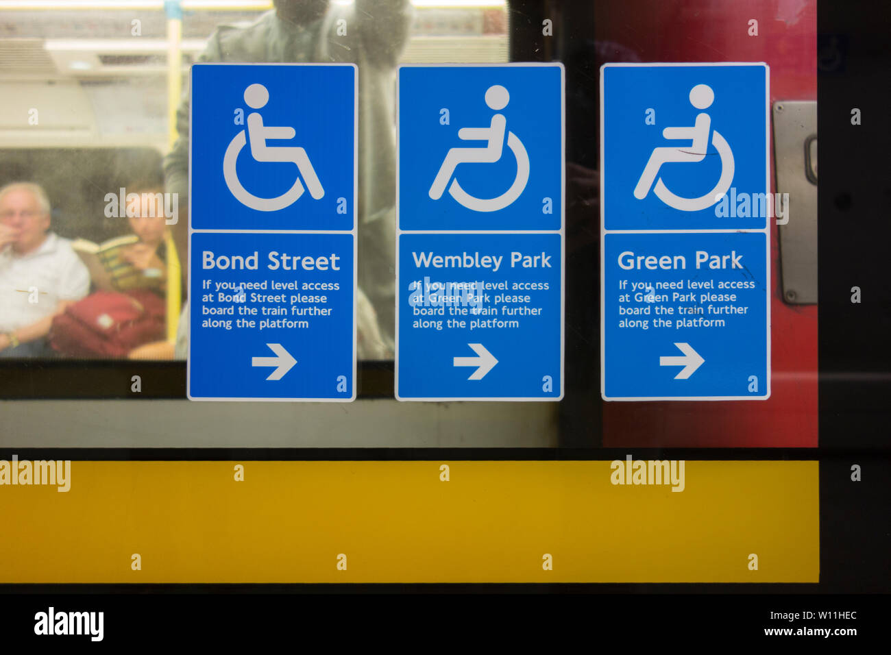 Wheelchair disabled access signage on the Jubilee Line at London's Waterloo Station - Stock Image