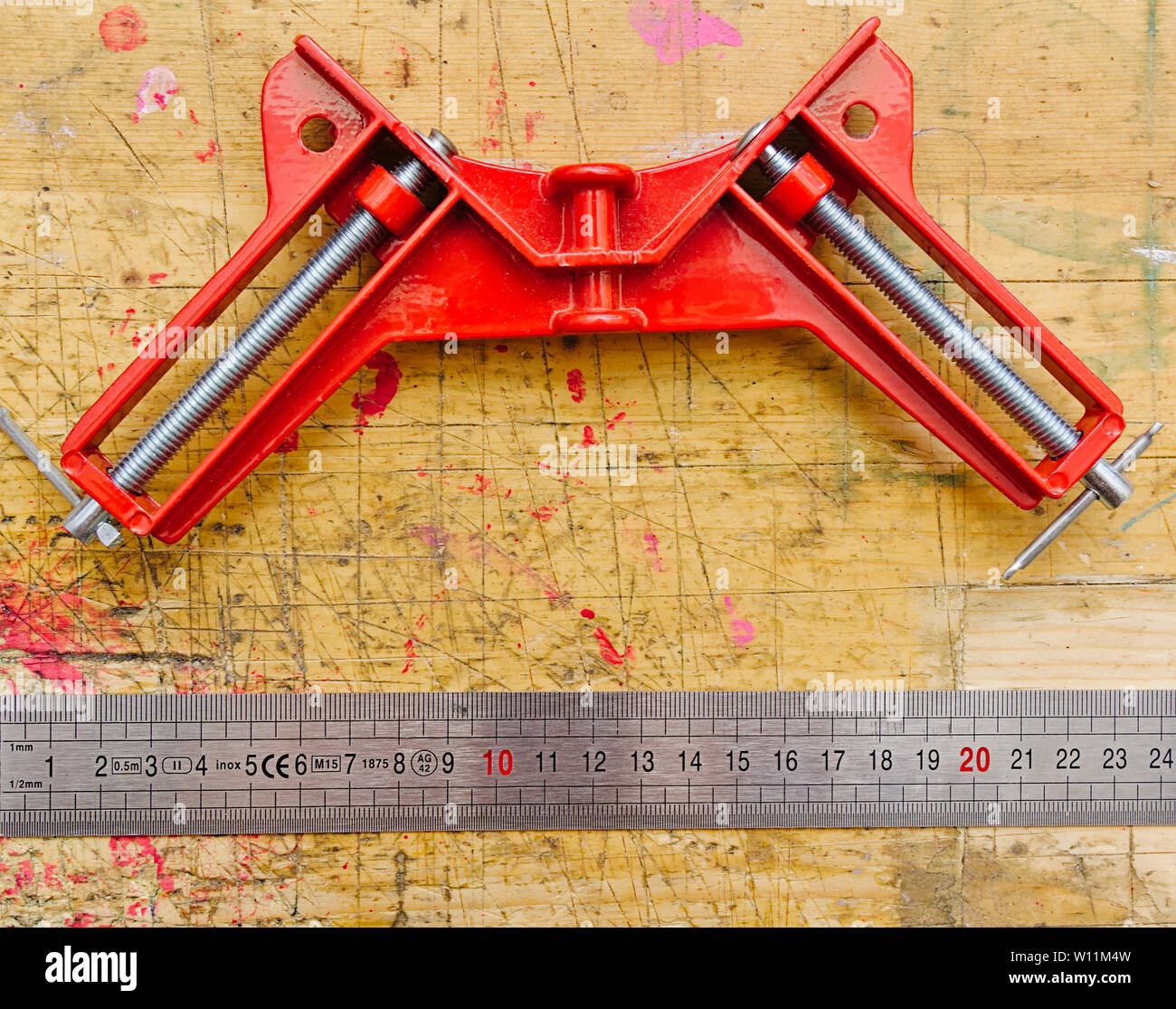 Superb Angle Clamp And Ruler On Red Paint Stained Wooden Workbench Andrewgaddart Wooden Chair Designs For Living Room Andrewgaddartcom