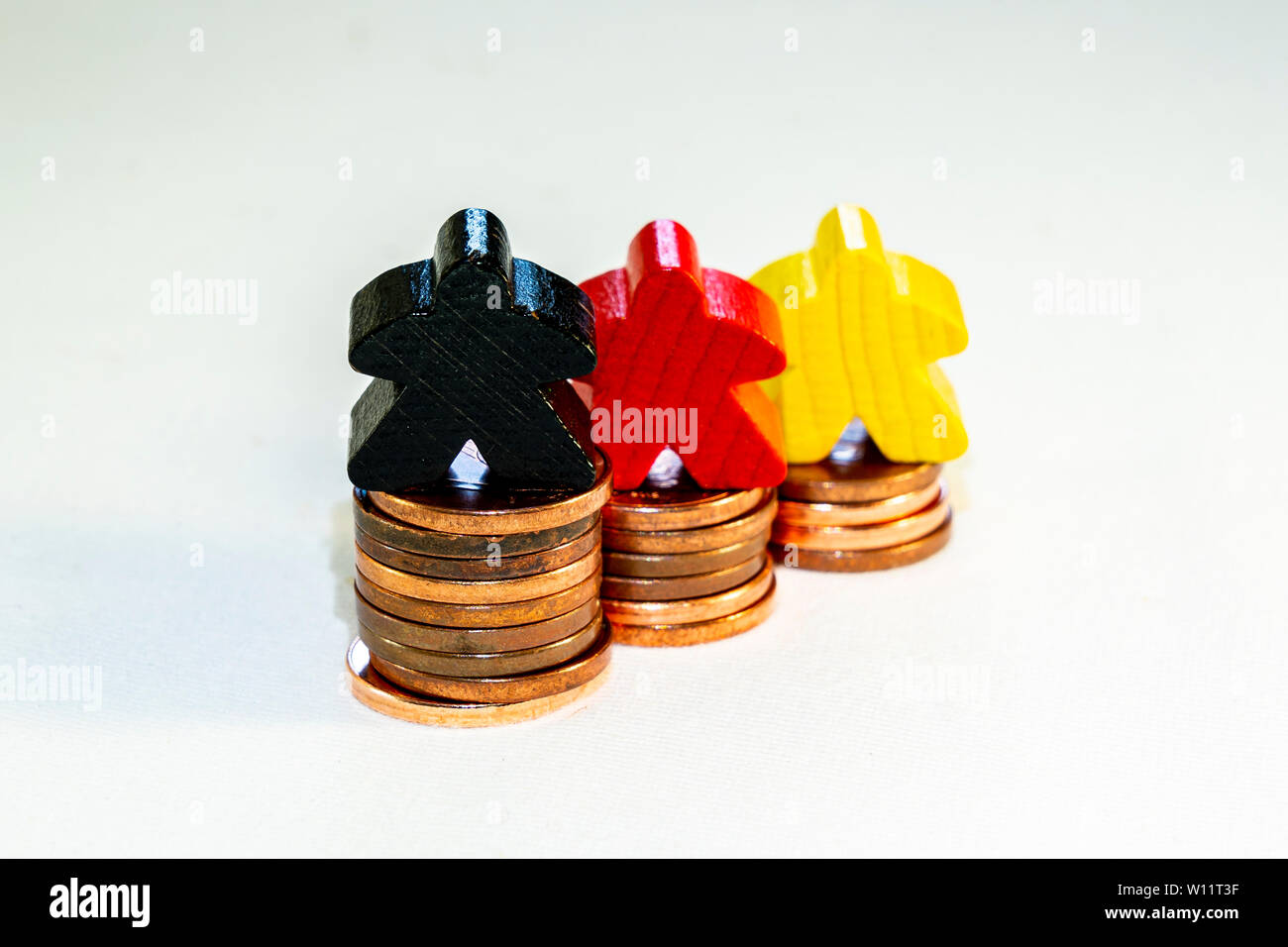 illustration of financial success concept with figurines on euro cents - Stock Image