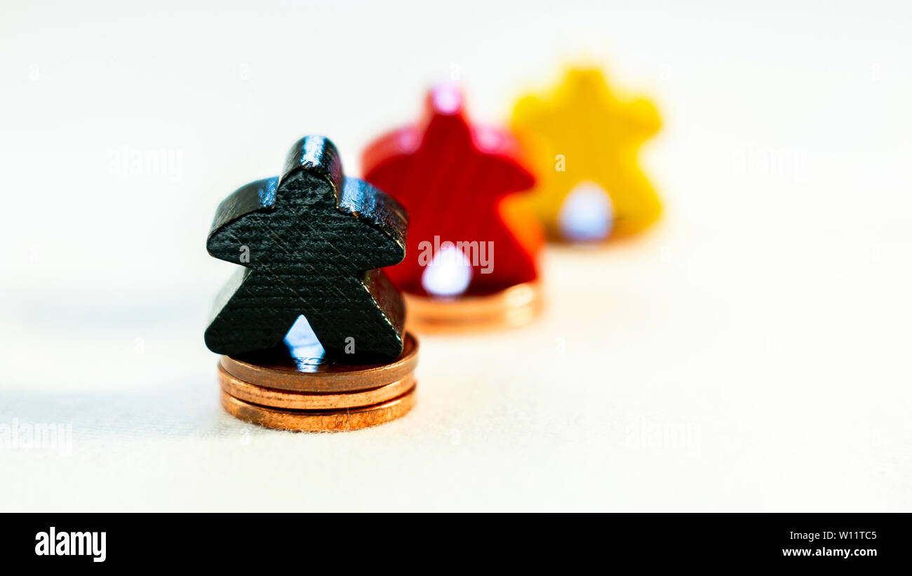 success story of a company in germany shown with wood figurines and coins - Stock Image