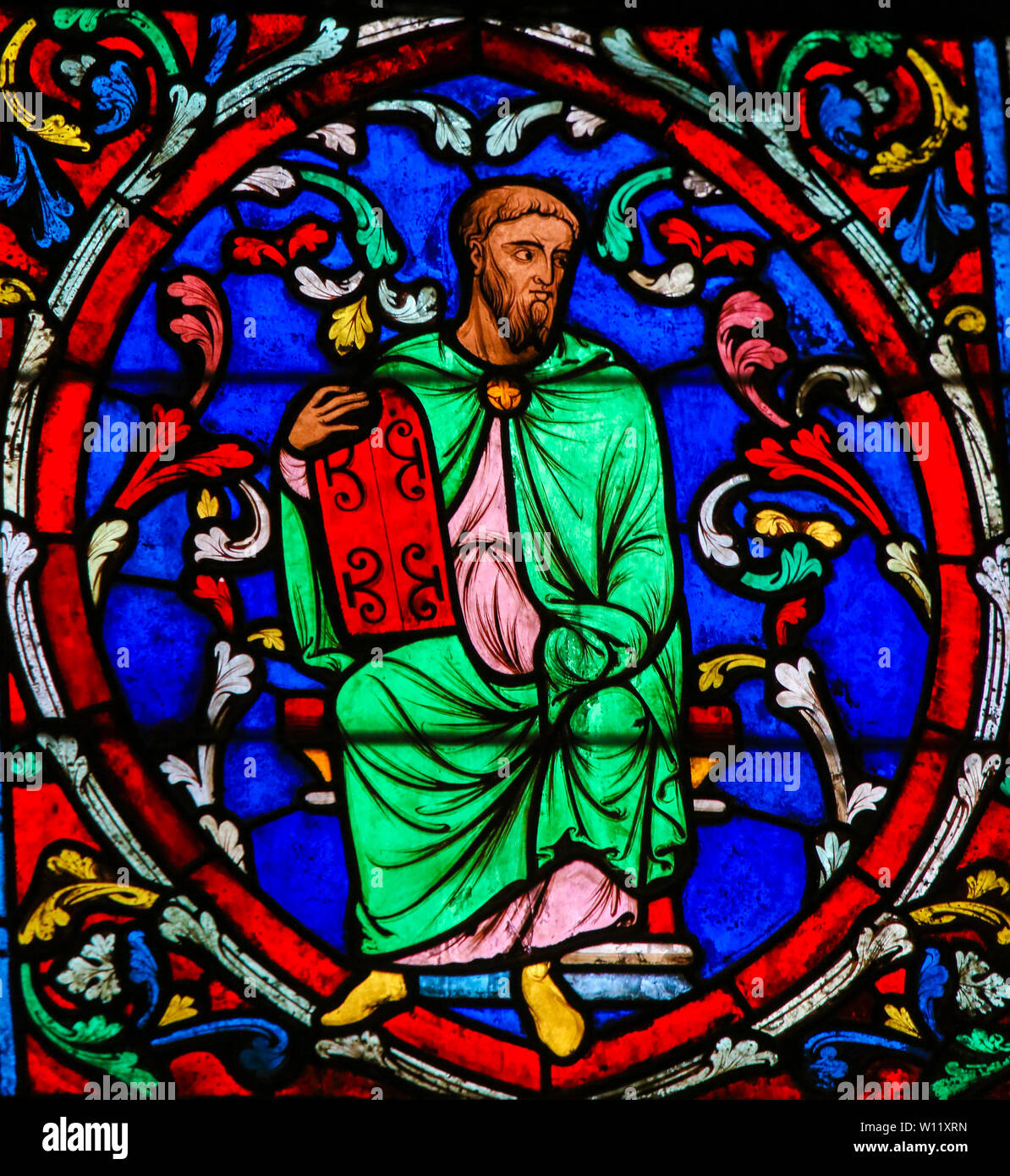 Stained Glass in the Cathedral of Notre Dame, Paris, France, depicting Moses carrying the Stone Tablets with the Ten Commandments Stock Photo
