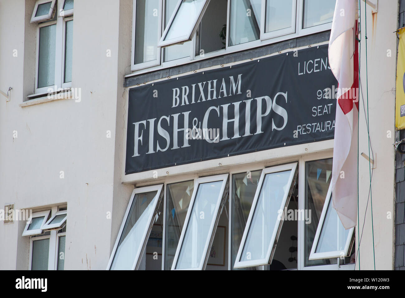 Brixham Fish & Chips next to Brixham Harbour in June. Fishing and tourism are the town's main industries. Devon England UK GB - Stock Image