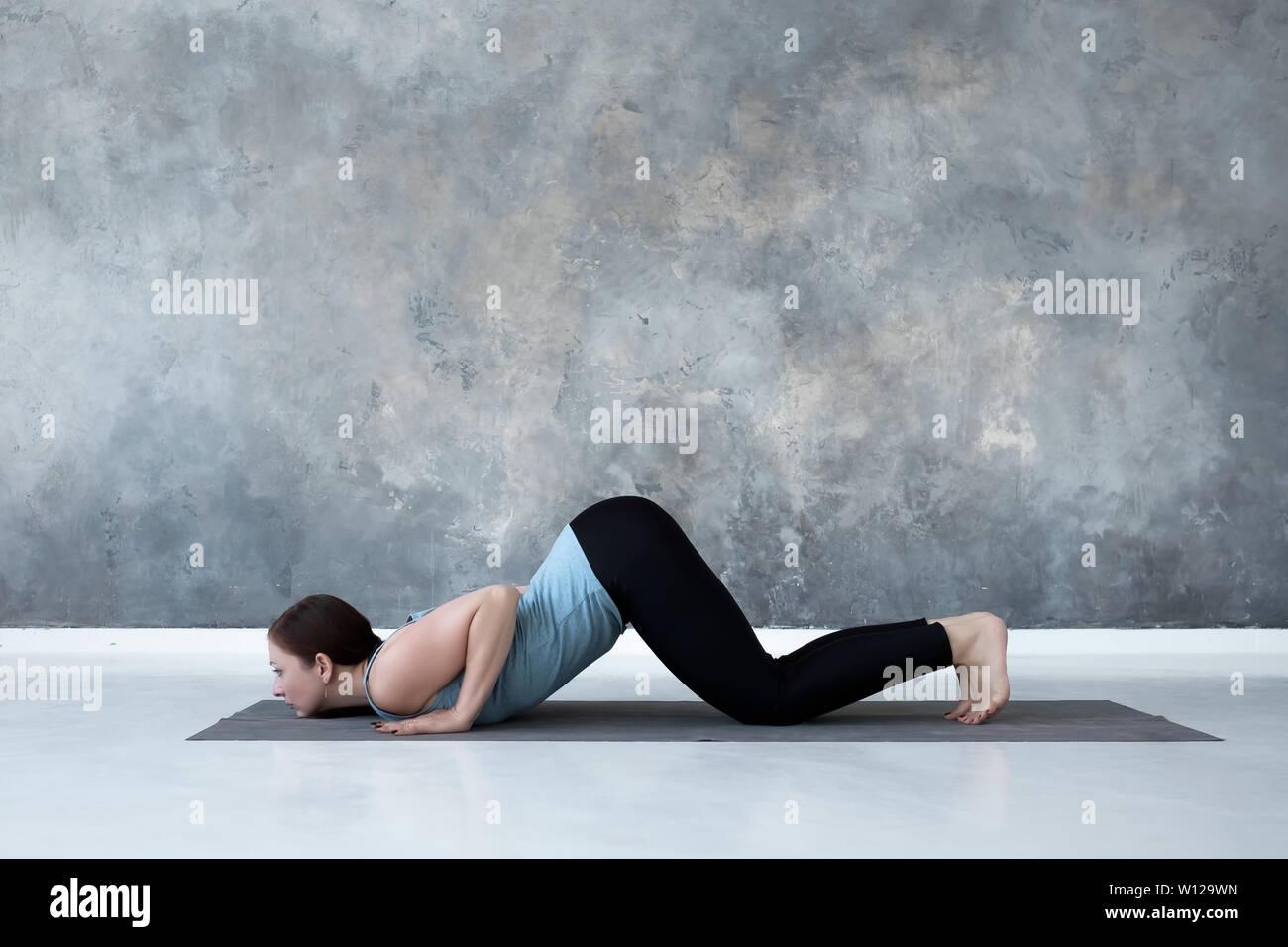woman practicing yoga, doing Ashtanga Namaskara from Sun salutation. - Stock Image