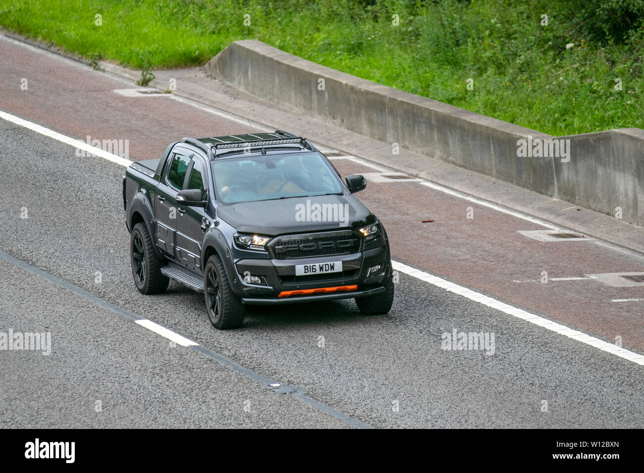 2018 black Ford Ranger Wildtrak 4X4 TDCI; M6, Lancaster, UK; Vehicular traffic, transport, modern, saloon cars, north-bound on the 3 lane highway. - Stock Image