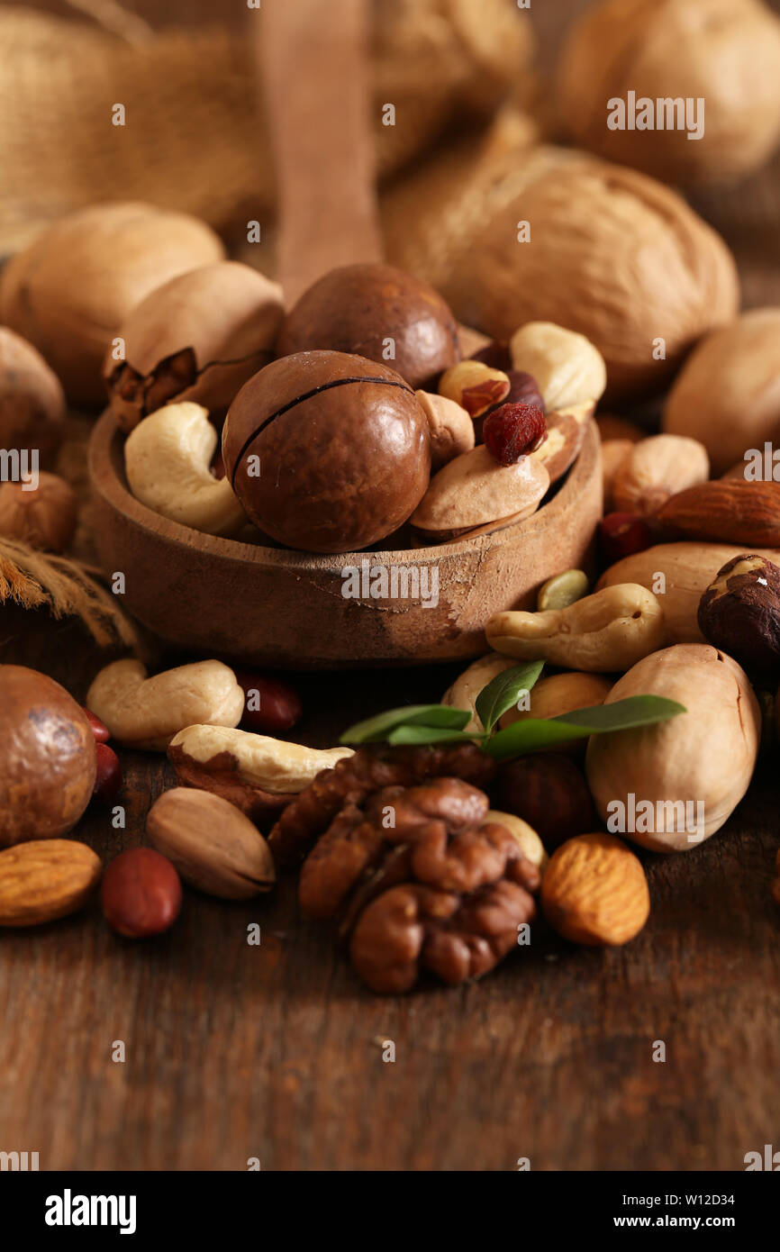 organic mix nuts on a wooden table Stock Photo