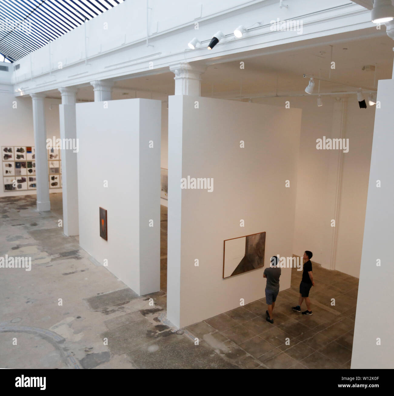 Los Angeles, USA. 28th June, 2019. People visit an exhibition of Argentine artist Guillermo Kuitca at Hauser & Wirth in Los Angeles, the United States, on June 28, 2019. Evoking the complex geometries and layered information of architectural plans and cartographic maps, Kuitca's theatrical paintings explore themes of dislocation. Credit: Li Ying/Xinhua/Alamy Live News - Stock Image
